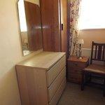mismatched furniture in bunk bedroom