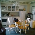 Kitchenette with Fridge, Dishwasher, Stove and Dining Table