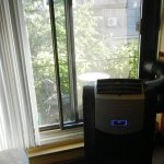 Air conditioner and sliding door to patio
