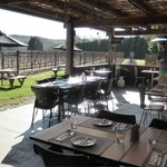 The outdoor eating area with the lovely view over the vineyard