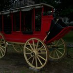 Stagecoach and Covered Wagon in Front of Inn