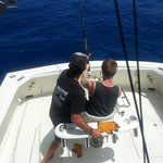First mate Lee giving instruction on how to reel in a Marlin.