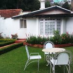 Private lawn with old world iron furniture