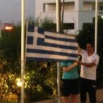 Making sure the Rep remembers what the Greek National Flag looks like