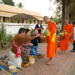 Takbaht, offering food to monks.