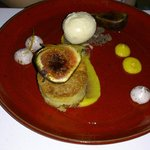 Caramelized figs, frangipane, orange puree, rosemary ice cream, cocoa meringue