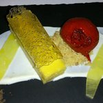 Passionfruit curd tart coconut lime yoghurt, raspberry sorbet, pop rocks, compressed pineapple