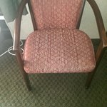 The chair is outdated, scratched, and faded.