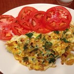 Spinach and feta Omelette with side of tomatoes.