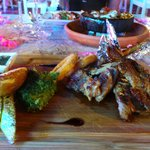 Delicious lamb chops presented on a wooden plater