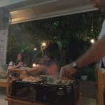 Our seafood dinner is being cooked at our table
