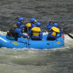 Rafters playing in the rapids