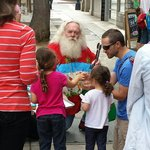 Santa on vacation in San Diego giving out donuts to the kids....priceless