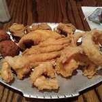 Butterflyed shrimp, catfish along with oysters and hush puppys