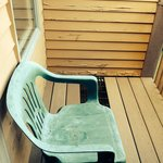 Chairs on deck with peeling exterior paint