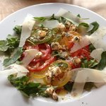 Salad of summer tomatoes, feta cheese, crushed pine nuts,watercress