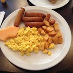 3 Eggs, sausage, home fries and brown toast breakfast (the toast comes on a separate plate)