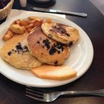 Blueberry pancakes and home fries