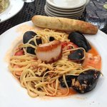 Delicious Drunken Seafood Pasta Mussels, scallops, shrimp, and clams in a tomato vodka sauce