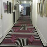 One of the many funkily carpeted halls with fun art
