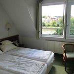 Room 205, top floor, dormer windows.