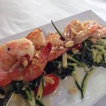 Shrimp with Swiss chard and julienne zucchini.