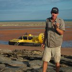 Miles (tour guide) with hovercraft on mud flats