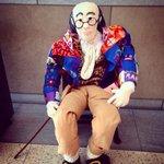 Ben Franklin sitting inside the building.