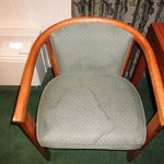 1st of 2 stained chairs in room