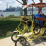 Quadricycle and city skyline from island