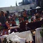 25 year spring break reunion. packed gross swimming pool