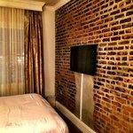 exposed brick wall and flat screen tv