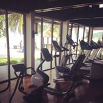 The cardio section of the gym with a view of the ocean