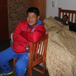(Photo caption: A half-frozen Nonoy Neri sits in front of the portable room heater inside Dapudo