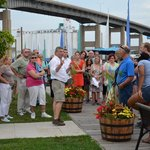 Discussing Buffalo's history at the boardwalk in Canalside.