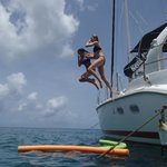Fun jumping from the boat