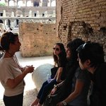 In the shade of the colosseum with our guide, Daniela