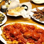 lamb chops, penne and meatballs, and grilled vegetables