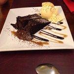 Dessert: warm chocolate fudge with vanilla ice-cream and chocolate & toffee sauce