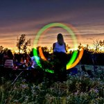 light art at sunset drum circle
