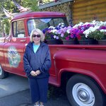 Antique Truck load with flowers for season sits in front of lodge