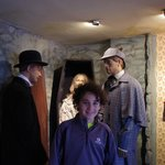 My son next to Watson and Sherlock