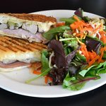 Sandwich on Foccaccia Bread with side salad