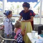 The kids getting Snow White's autograph