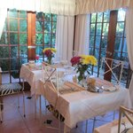 Amazing dinning room with FRESH flowers on tables