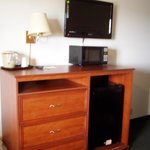 Room with flat screen tv, small microwave & refigerator