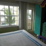 The very colorful 2nd bedroom, with balcony, in 2-bedroom suite