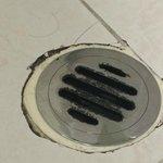 Dirty broken drain in bathroom, with hair