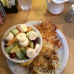 Bowl of fruit and side of hash browns! Lots of food for a little price!