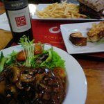 Mouth watering Scotch Fillet with Mushrooms and red wine.